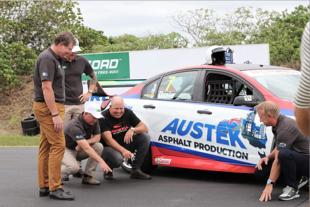 Racecar drivers checking out the new Carbonphalt race track in Queensland, Australia