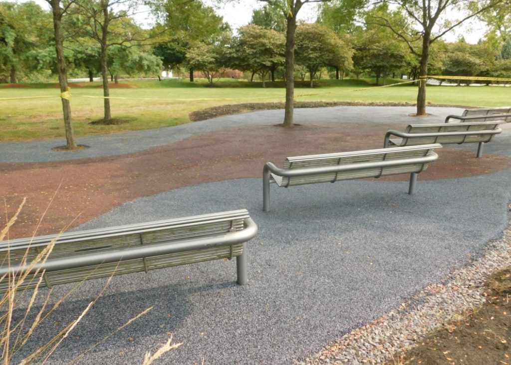 Benches surrounded by rubberized paths