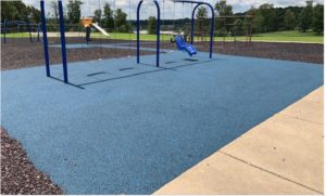 a playground in Kentucky with a crumb rubber play surface